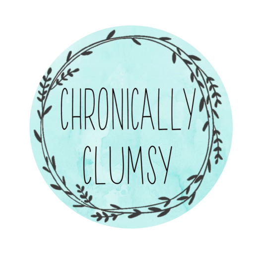 "Chronically Clumsy logo:  Blue circle with inner circle made of sprays of lavender Text saying ""Chronically Clumsy"" in the centre"